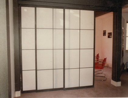 """Design Shoji doors with faux stone finish"""