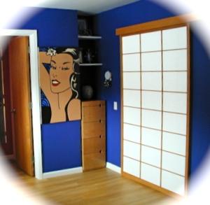 Blue walls and mangia artwork beside a Design Shoji door