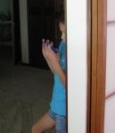 child standing by shoji screens